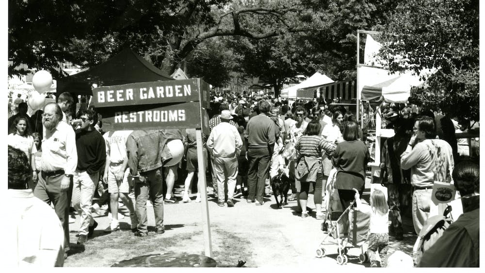 COURTESY OF THE UNIVERSITY ARCHIVES — SHERIDAN LIBRARIES Spring Fair attendees enter the beer garden in 1994, around the time Goldstein and Stephan were appreciating the drink.
