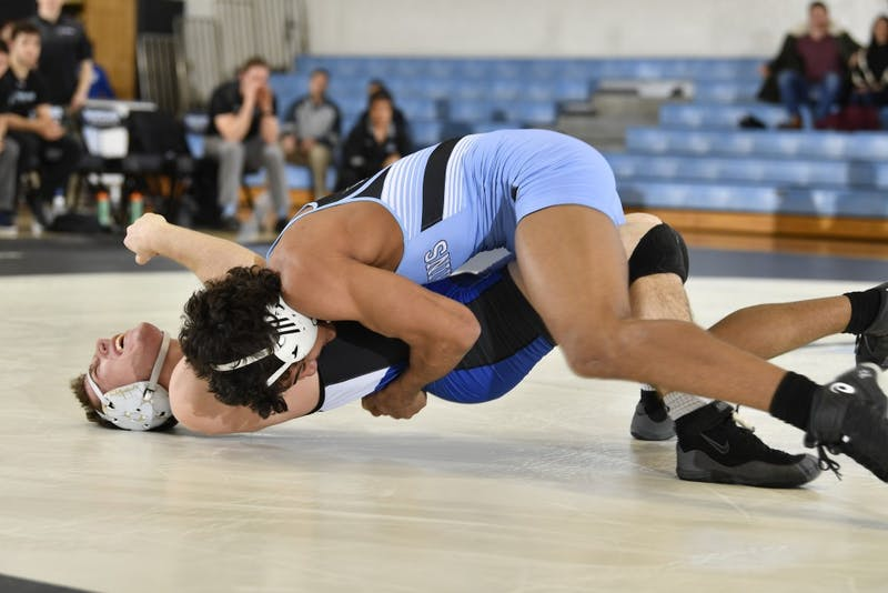 COURTESY OF HOPKINSSPORTS.COM  Sophomore Dominick Reyes fights through consolation bracket to take third overall in weight class.