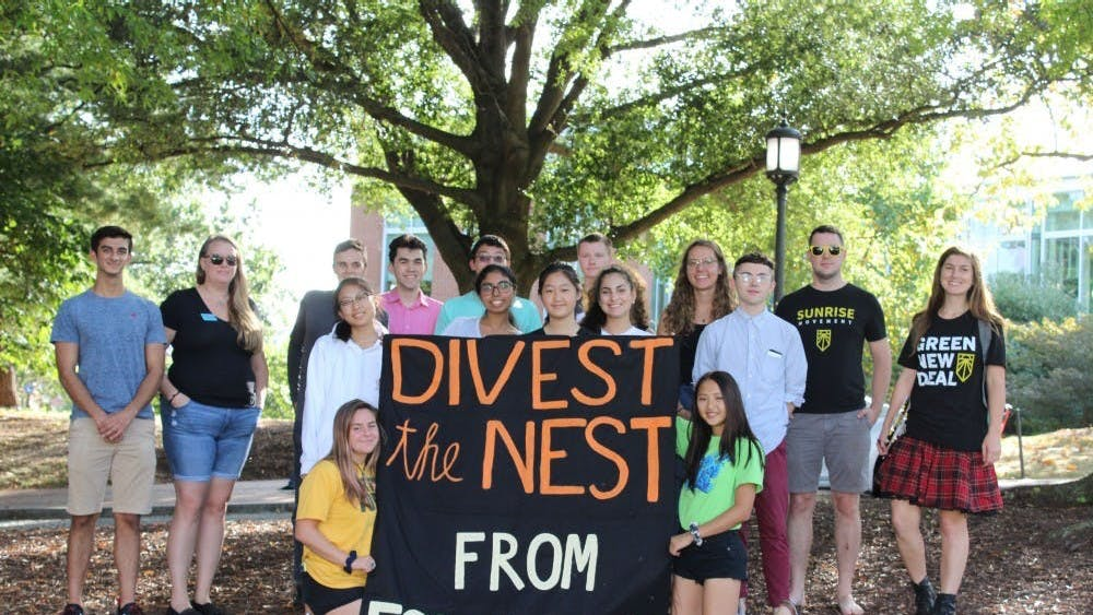 NEHA SANGANA/PHOTOGRAPHY EDITOR Members of Refuel Our Future at their first DivestFest event in September 2019.