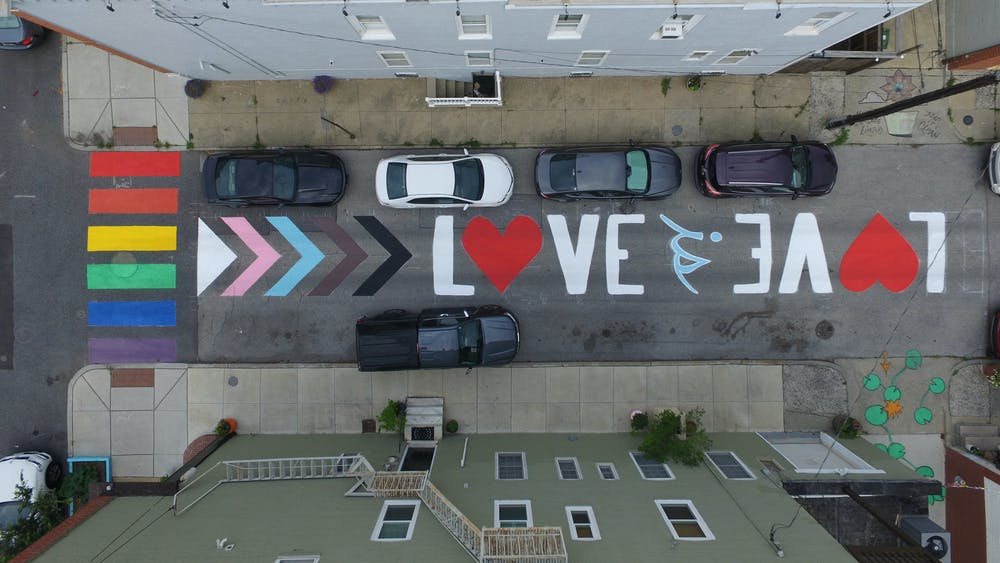 COURTESY OF CHRIS BEALL The Love is Love street mural adorns North Curly Street in Patterson Park.