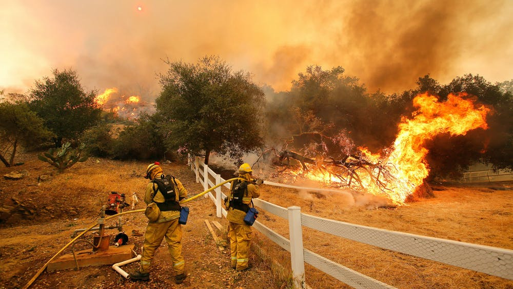 MEL MELCON / CC BY 2.0 Firefighters put out a wildfire in Hidden Valley in 2013.