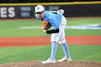 HOPKINSSPORTS.COM Senior pitcher Josh Hejka records his 100th career strikeout on Tuesday.
