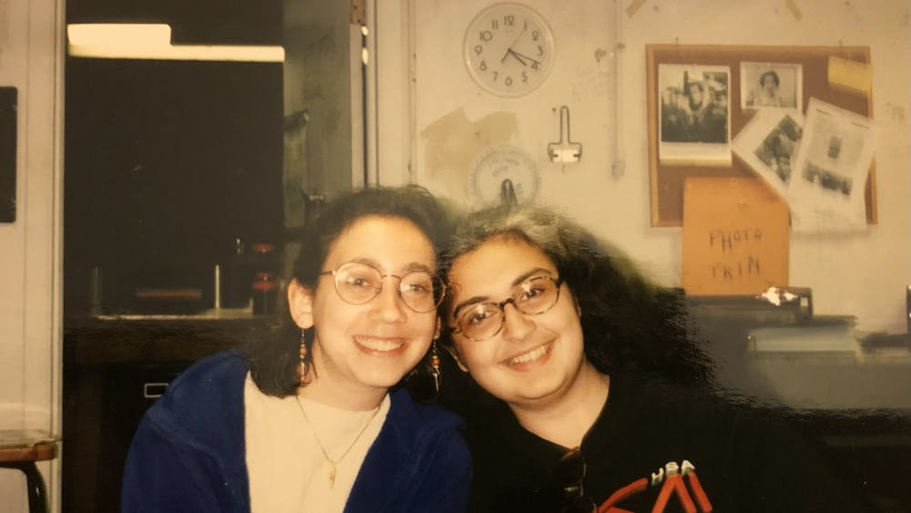 COURTESY OF EMILY SCHUSTER Schuster (left) and Jha (right) pictured in the Gatehouse in 1997 when they were both Features Editors.