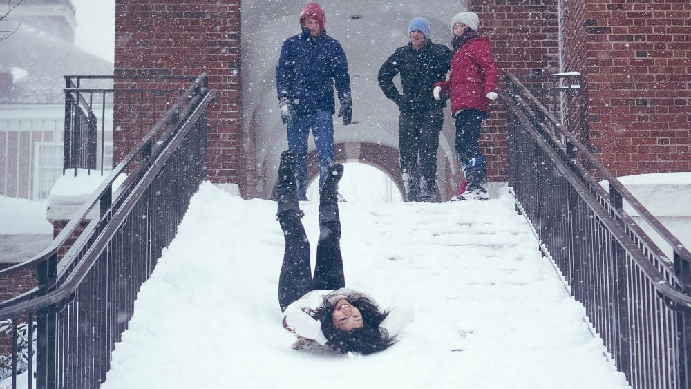 COURTESY OF THE JOHNS HOPKINS PHOTO GRAPHY FORUM A member of the forum took pictures of Hopkins students in the snow.