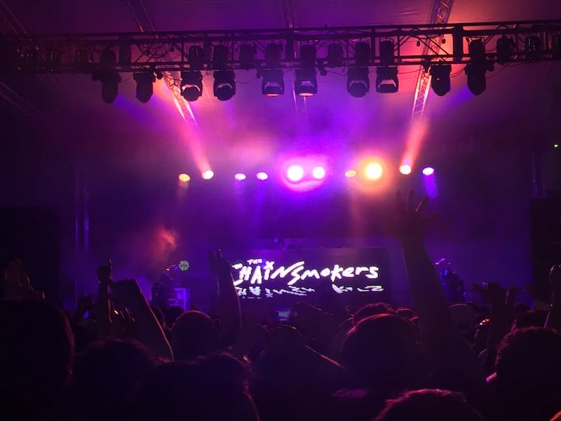 COURTESY OF ERIC CHEN/THE JOHNS HOPKINS PHOTOGRAPHY FORUM The Chainsmokers, a DJ duo, performed on the practice field at the Spring Fair concert this year.