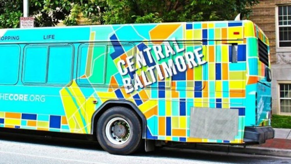 COURTESY OF EXPLORE THE CORE! CENTRAL BALTIMORE The new stickers on the JHMI buses advertise the Homewood Community Partners Initiative's campaign to invest in Baltimore.