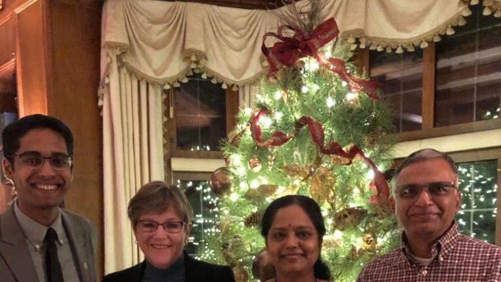 COURTESY OF VIJAY RAMASAMY  Ramasamy is pictured on the left, along with with Laura Kelly, the governor of Kansas, and his parents.