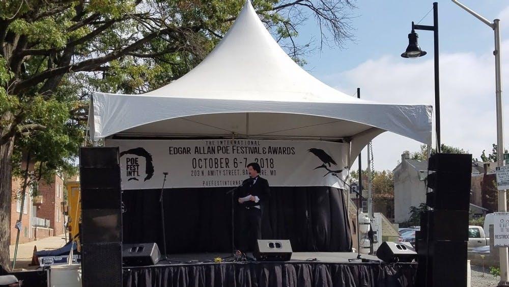 COURTESY OF ARIELLA SHUA Master of Ceremonies Tim Beasley imitating Edgar Allan Poe onstage.