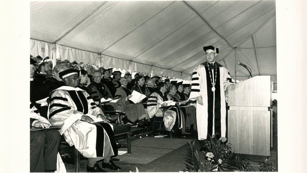 COURTESY OF THE JOHNS HOPKINS UNIVERSITY GRAPHIC AND PICTORIAL COLLECTION Then-University President William C. Richardson speaks at Edelman's graduation in 1992.