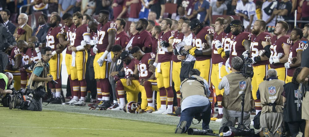 washington-redskins-national-anthem-kneeling-37301887651-cropped
