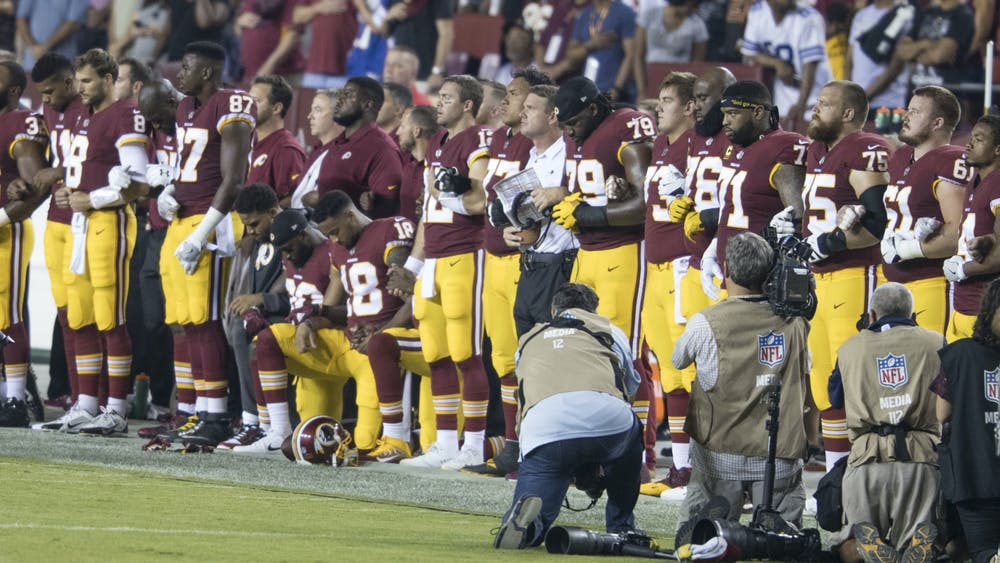CC by - 2.0 The NFL is now doing the bare minimum by allowing its players to protest without fear of consequence.