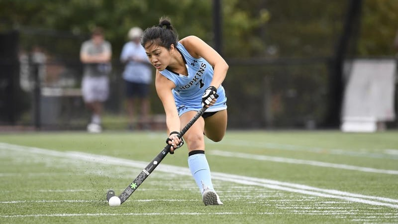 HOPKINSSPORTS.COM The field hockey team is undefeated in Conference play this year.
