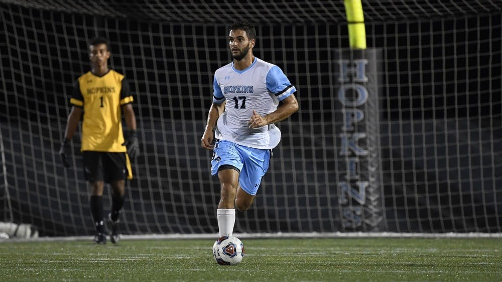 COURTESY OF HOPKINSSPORTS.COM  Senior defender Cole Rosenberger knocks in a goal to help lift the team to a 3-0 shut out against the Bears.