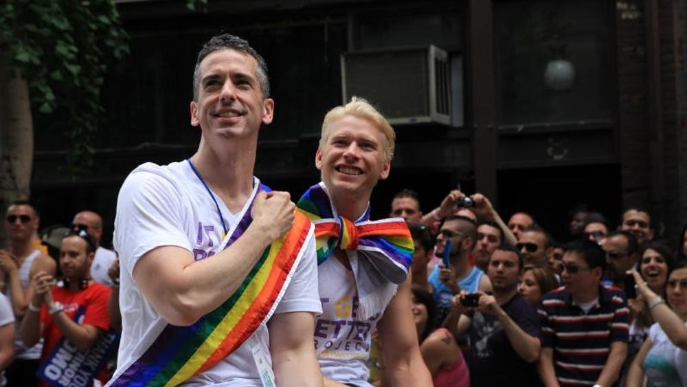 CHRISJTSE/CC BY 2.0 Dan Savage (left), creator of the Hump! film festival, is an author, journalist and LGBT activist. He is pictured with his husband, Terry Miller.