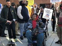 COURTESY OF CHRIS PARK Attendees protested potential JHPD presence in Douglass Homes.
