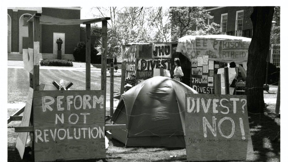 COURTESY OF THE UNIVERSITY ARCHIVES — SHERIDAN LIBRARIES Students protest against apartheid in South Africa in 1986, when Iosso wrote for The News-Letter.
