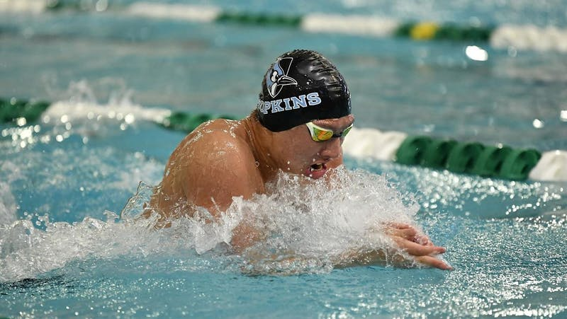 HOPKINSSPORTS.COM Men's and women's swimming had several victories over the weekend, breaking new records.