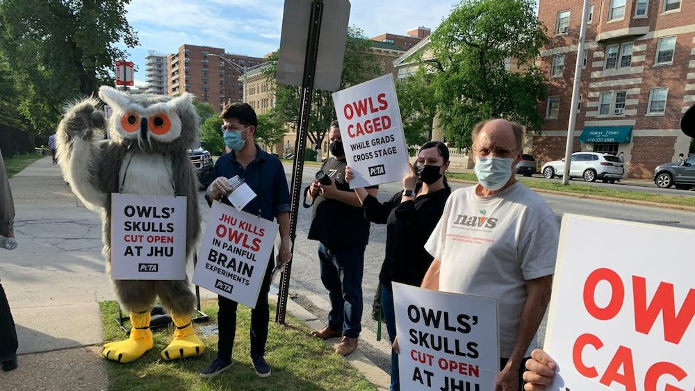 COURTESY OF TASGOLA BRUN PETA protesters, including an owl mascot, lined the entrance to the University's commencement celebration on Thursday evening.