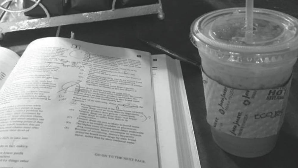 COURTESY OF JISOO BAE A Vietnamese coffee and a peaceful study table at The Bun Shop.