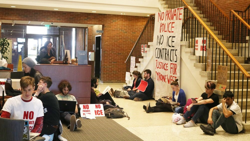 EDA INCEKARA/PHOTOGRAPHY EDITOR The sit-in began at Garland Hall on Wednesday, April 3 at 1 p.m. Students Against Private Police and the Hopkins Coalition Against ICE organized the protest.