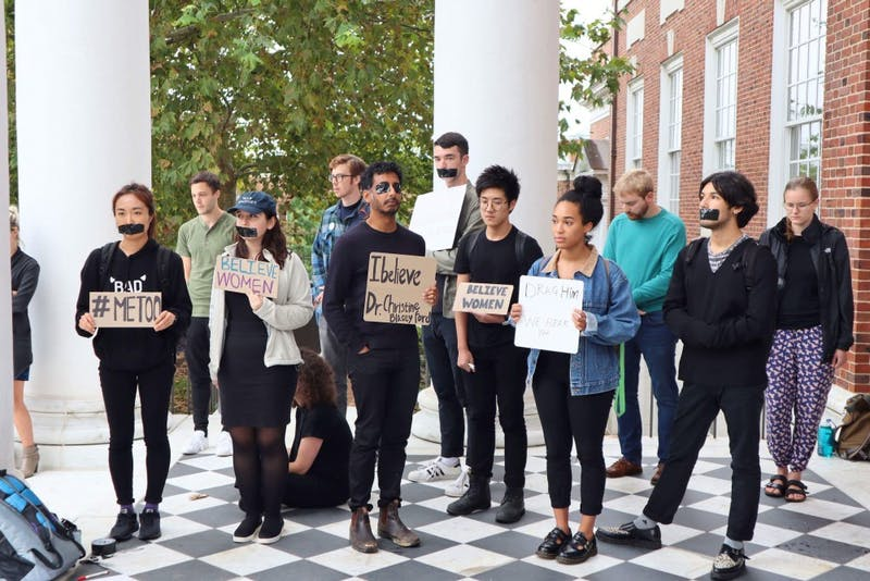 COURTESY OF TEACHERS AND RESEARCHERS UNITED Hopkins community members gathered in front of Gilman to silently support Christine Blasey Ford.