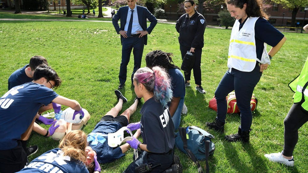 COURTESY OF HOPKINS EMERGENCY RESPONSE ORGANIZATION HERO EMTs demonstrated their mass casualty incident drills to University President Ronald J. Daniels in spring 2019.