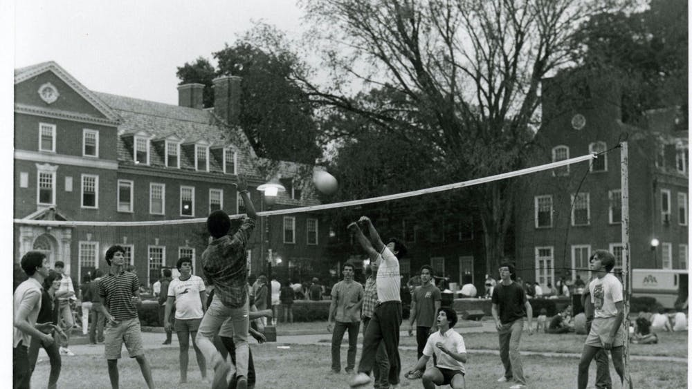 COURTESY OF THE UNIVERSITY ARCHIVES — SHERIDAN LIBRARIES Students play volleyball on Freshman Quad in 1980, when Kun began his humor column.
