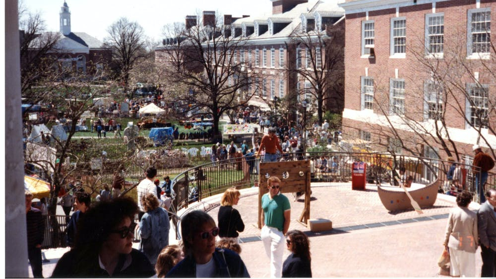 COURTESY OF THE JOHNS HOPKINS UNIVERSITY GRAPHIC AND PICTORIAL COLLECTION Spring Fair attendees walk around Wyman Quad in 1988, the same year Winfield arrived at Hopkins.