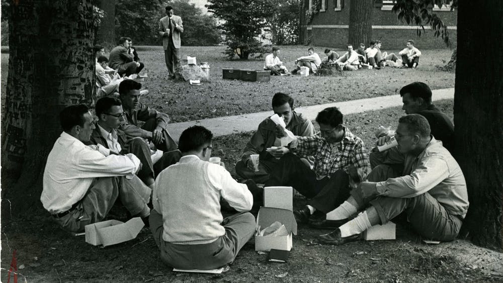COURTESY OF THE UNIVERSITY ARCHIVES — SHERIDAN LIBRARIES Students picnic next to Homewood House circa 1950, around when Griffith was Editor-in-Chief.