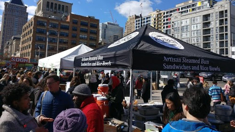 COURTESY OF JESSE WU Ekiben's stall at the Baltimore Farmers Market & Bazaar draws crowds.