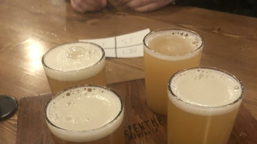COURTESY OF SABRINA ABRAMS  Nepenthe offers flights, giving patrons the chance to sample four different beers.