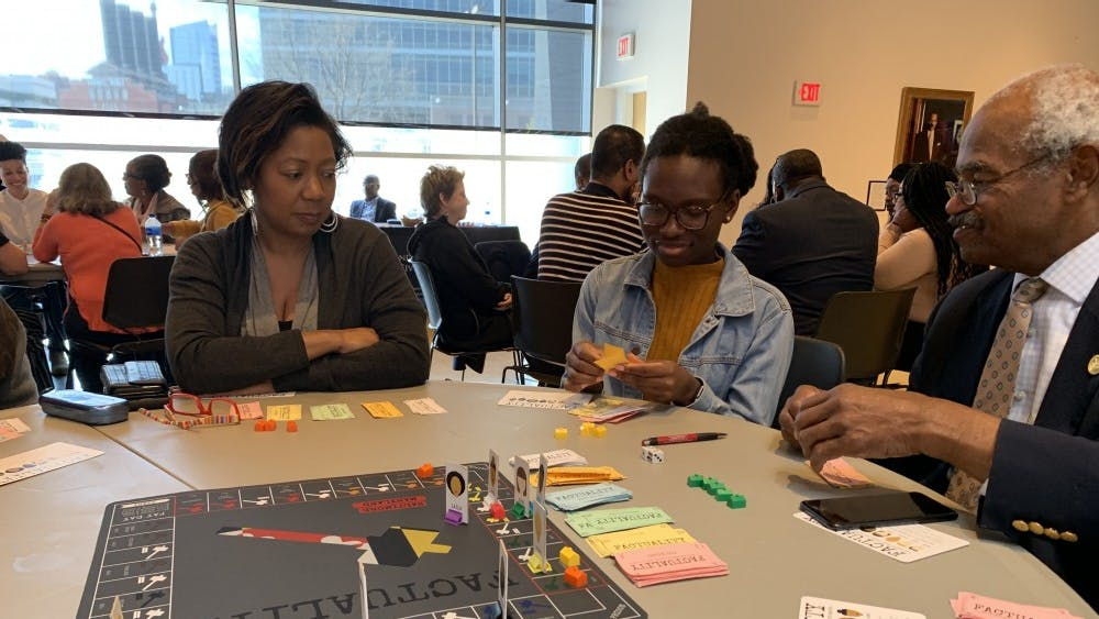 Event attendees played the board game Factuality, where they acted as characters with different identities.