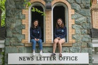 NEHA SANGANA / PHOTOGRAPHY STAFF Ome and Ko celebrate the time they've spent working on The News-Letter