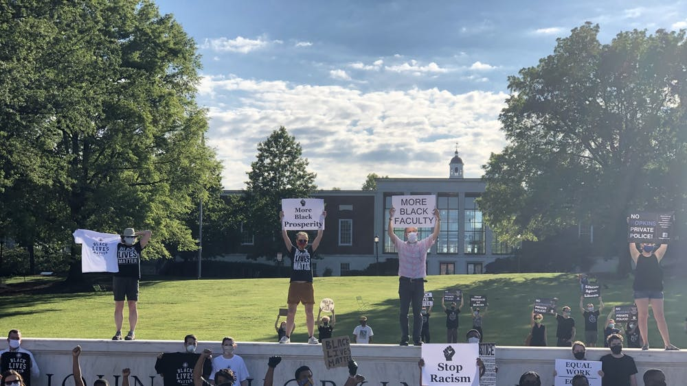 COURTESY OF RUDY MALCOM The Black Faculty and Staff Association organized a peaceful demonstration on the eve of Juneteenth, a holiday celebrating emancipation.