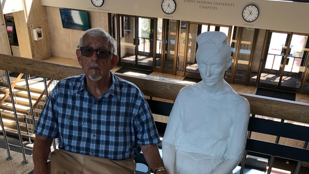 """COURTESY OF CALEB DESCHANEL """"Henry James Korn and a plastered friend on a recent visit to the Milton S. Eisenhower Library."""""""