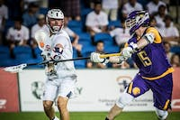 COURTESY OF JAKE FOX Jake Fox (right) playing on the Iroquois Nationals at the 2018 FIL World Championship.