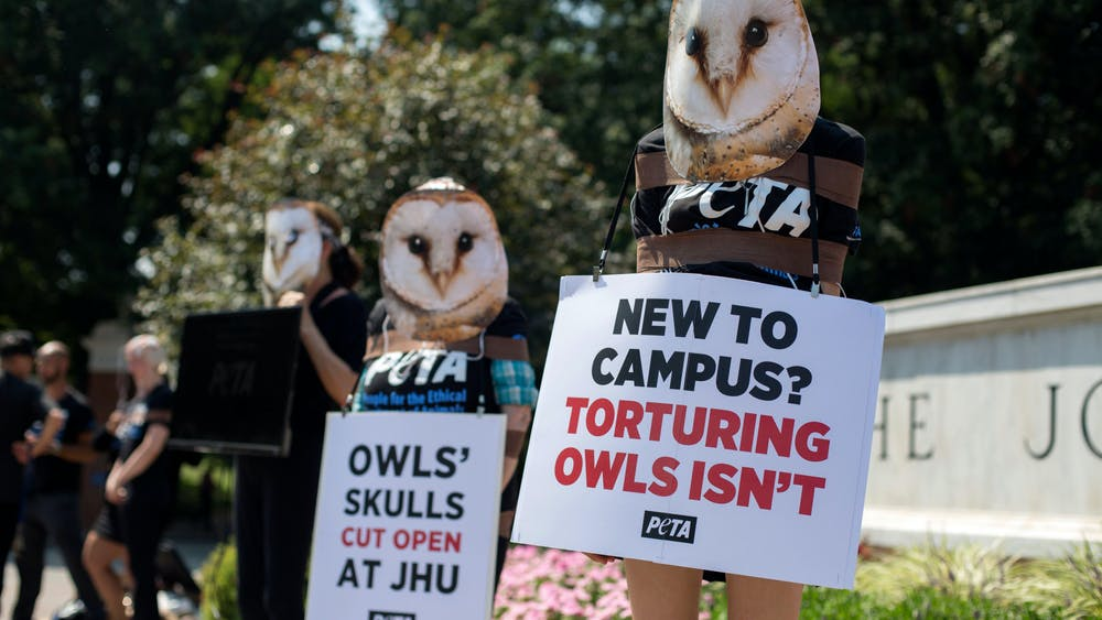 COURTESY OF CAITLIN CAMPBELL PETA protesters appeared in front of the University sign to protest barn owl experiments in the lab of Shreesh Mysore.