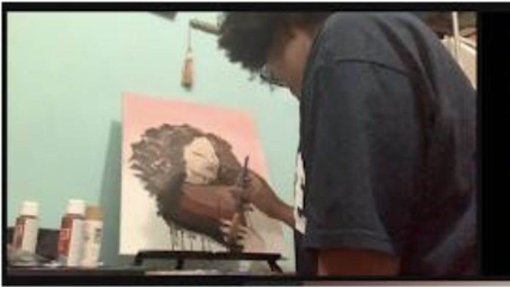 """COURTESY OF SARAH JUNG Artists Shayla-Mona'e Russell and Dylan Aiello paint their interpretations of the poem """"La Negra."""""""