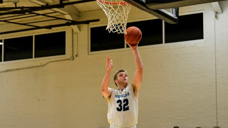 HOPKINSSPORTS.COM M. basketball earned second place in the Centennial Conference this season.