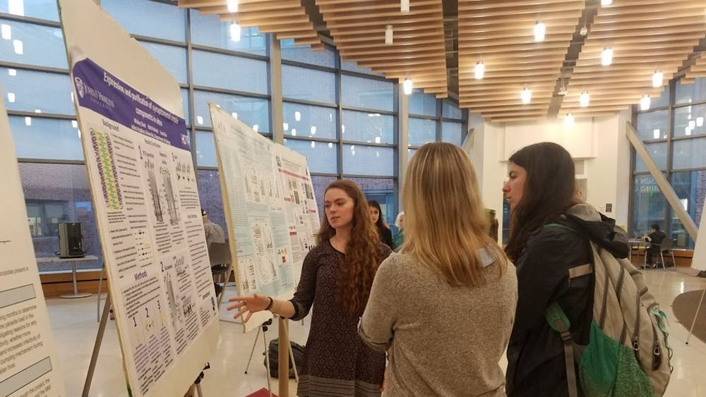 Mickey Sloat presents her research at TriBeta poster session.