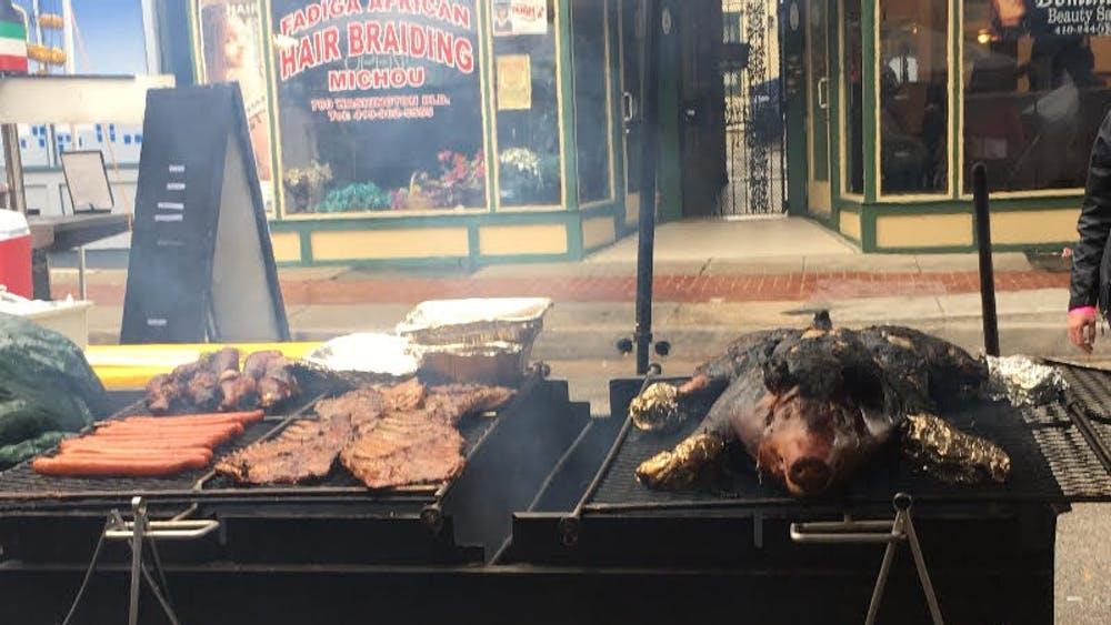 COURTESY OF ALYSSA WOODEN The Pigtown festival spanned several blocks of Washington Boulevard and offered pig and non-pig foods.