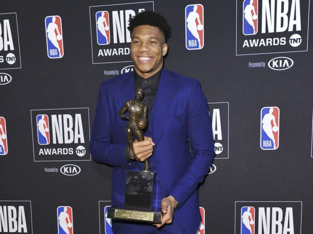 COURTESY OF RICHARD SHOTWELL Milwaukee Bucks forward Giannis Antetokounmpo beams as he holds his 2018-19 MVP award.