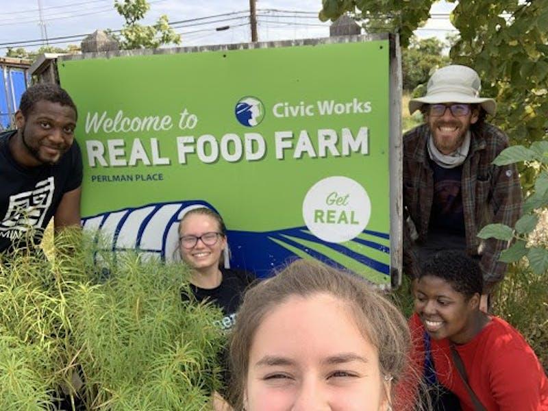 COURTESY OF LAÍS SANTORO Santoro and members of Real Food Hopkins volunteer at Real Food Farm in Baltimore.