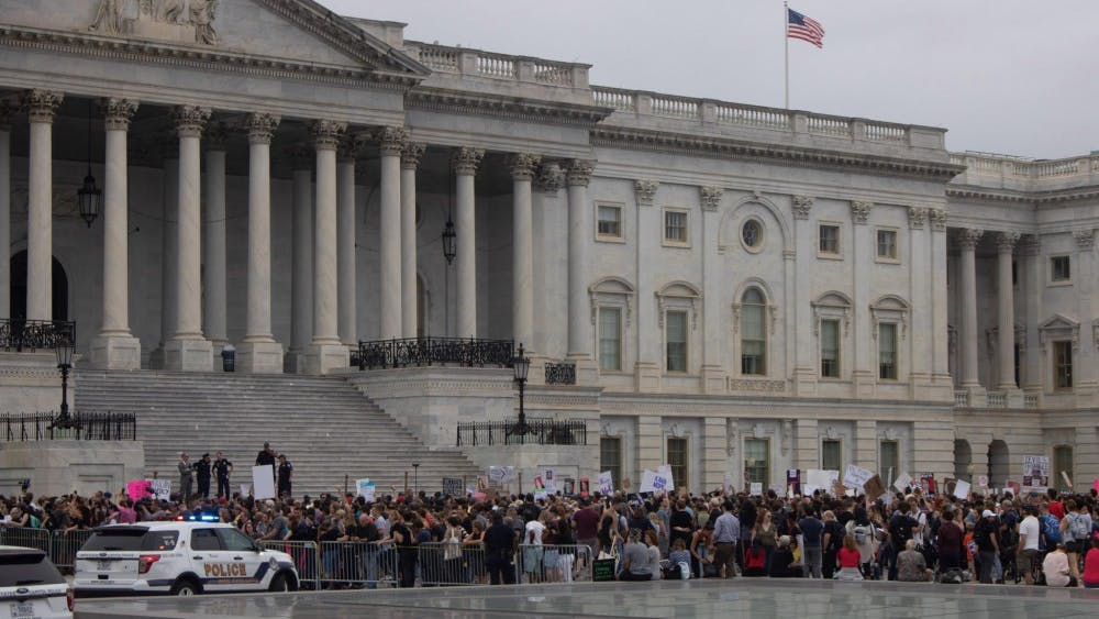 COURTESY OF EDA INCEKARA  Protesters rallied at D.C. on Saturday in opposition to Kavanaugh's confirmation vote.