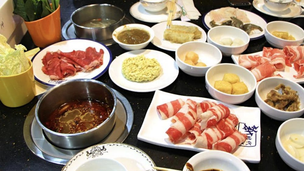COURTESY OF ALAN FANG Meat, vegetable, seafood and other foods to be tossed into boiling soup.