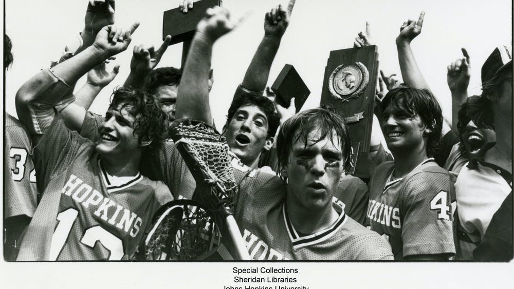 COURTESY OF THE JOHNS HOPKINS UNIVERSITY GRAPHIC AND PICTORIAL COLLECTION Members of the lacrosse team celebrate after winning 1980 NCAA Championship, which occurred during Kruzansky's time with the sports section.