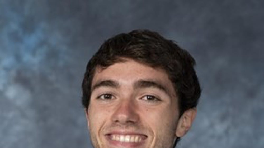 HOPKINSSPORTS.COM Junior runner Jared Pangallozzi.