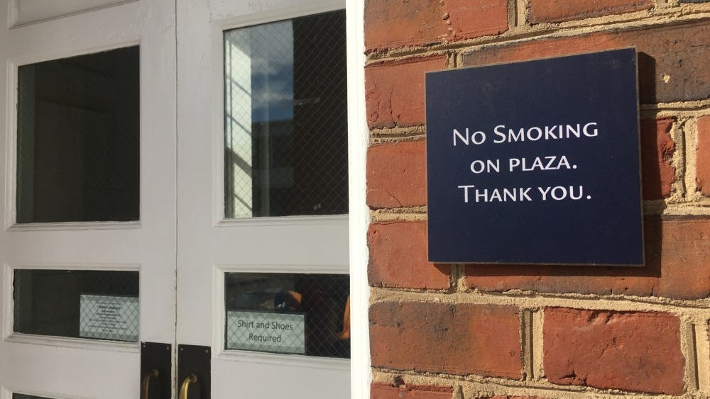 COURTESY OF MORGAN OME Although non-smoking signs are posted outside of several campus buildings, they are often disregarded.