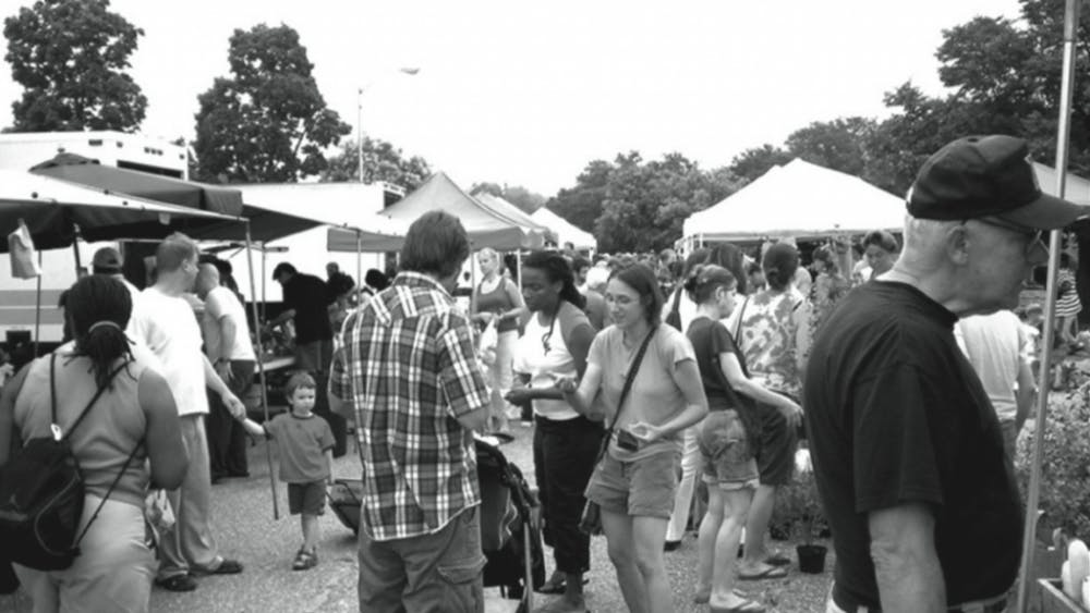 RICHARD LAYMAN/cc-by-nc-2.0 A typical, joyful Sunday morning at the Waverly Farmer's Market between 32nd and 33rd Streets.