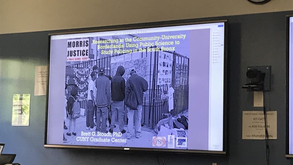 COURTESY OF DRAKE FOREMAN Stoudt discussed the implications of his research study on policing in NY.